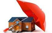 """Disengo di una casa """"protetta"""" da un ombrello"""